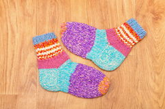 Wool colored socks. On a wooden background Stock Photos