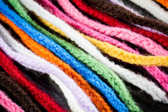 Wool colourful scarf. Closeup looks on colourful scarf showing the threads Stock Image