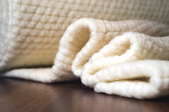 Wool Fabric on wooden table Stock Photos