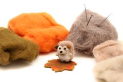 Wool for felting. Top view of wool needle felting isolated on white stock photo