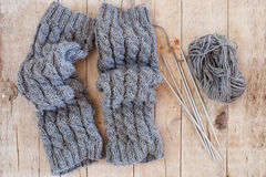 Wool grey legwarmers, knitting needles and yarn Stock Image