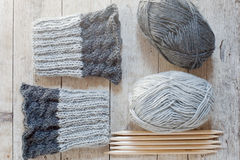 Wool grey legwarmers, knitting needles and yarn stock image
