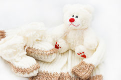 Wool hand-made baby coat, socks and teddy bear Stock Image
