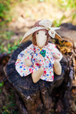 Wool handmade sheep in white dress with flowers and a cute bow on head Stock Photos