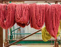 Wool hanging in a carpet factory Stock Photo