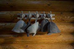 Wool hats and gloves on wooden hanger. Felt hats and gloves on wooden wall Royalty Free Stock Images