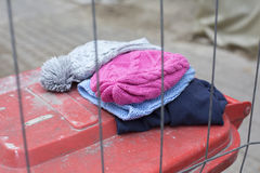 Wool hats on trashcan Royalty Free Stock Photo