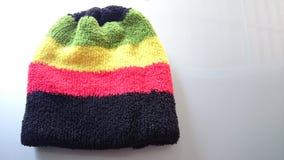 Wool-hats. Winter season colorful warm wool royalty free stock photos