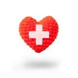 Wool heart with cross sign Stock Photos