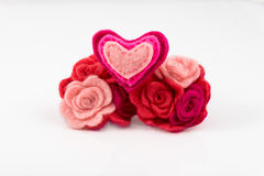 Wool heart with pink and red flowers on white Stock Photo