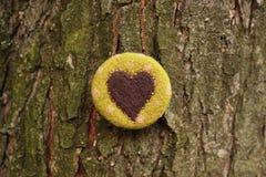 Wool heart. And tree bark Stock Photos