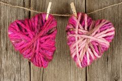 Wool hearts on clothesline Stock Photo