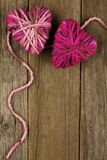 Wool hearts on old wood background Royalty Free Stock Image