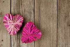 Wool hearts on wood Stock Photos