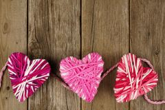 Wool hearts on wood Stock Images