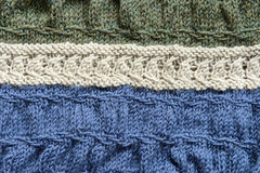 Wool Knit Blanket. A homemade wool blanket showing cable stitch, purl stitch, knit stitch, and slip stitch stock photography