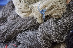 Wool for knitting. Grey and white wool balls for knitting Royalty Free Stock Images