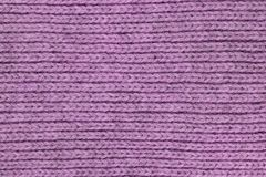 Wool knitting background texture, violet color , fabric, material, cloth. Close up. copy space royalty free stock photos