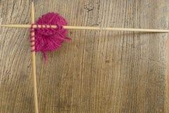 Wool and knitting needle border Stock Photos