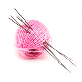 Wool with knitting needles over white Royalty Free Stock Photos