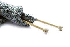 Wool knitting on wooden needles stock photos