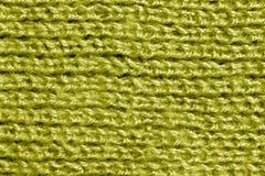 Wool knitting yellow pattern. Stock Photo