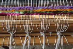 Wool Loom Weaving. Weaving a wool rug with a floor loom and wool roving Stock Photos