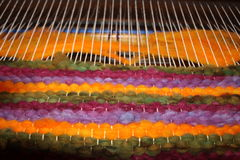 Wool Loom Weaving. Weaving a wool rug with a floor loom and wool roving Royalty Free Stock Photography