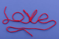 Wool love. Wool symbol lettering saying love on blue background Stock Photo