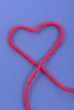 Wool love. Wool symbol lettering saying love on blue background Stock Images