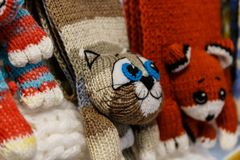 Wool mittens and gloves. As cats and rabbits royalty free stock image