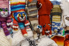 Wool mittens and gloves. As cats and rabbits royalty free stock photography