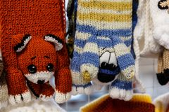 Wool mittens and gloves. As cats and rabbits stock photo