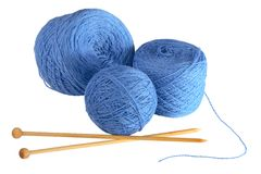 Wool needles. Three ball of yarn and two knitting needles on white background Stock Photos