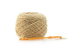 Wool and orange needle. On white background Stock Image