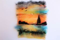 Wool Painting. Of a sunset, sailboat and birds using hand dyed sheep wool and natural sheep wool needle felting and layering techniques Stock Photography