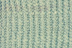 Wool pale blue fabric close up. Background with knitted texture, smooth rows. Photo for layouts royalty free stock image