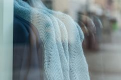 Wool pullover in fashion store showroom for women. Closeup of wool pullover in fashion store showroom for women Stock Image