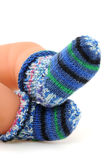 Wool for puppets feet. Multicolored wool-socks on white background Royalty Free Stock Photos