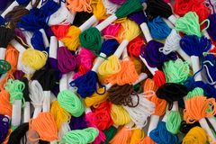 Wool rainbow. Many coloured samples of wool as a background royalty free stock images