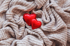 Wool, red hearts, pearl, Valentine card Royalty Free Stock Photography