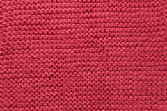 Wool red knitted fabric texture background. Real wool red knitted fabric texture background Stock Photography