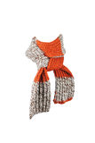 Wool scarf. Striped orange wool scarf on a white background royalty free stock photo