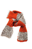 Wool scarf. Striped orange wool scarf on a white background stock photo