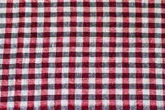 Wool scarf. The keffiyeh is a gender-neutral black, red or blue and white scarf that is usually worn around neck or head. Background texture, pattern. Scarf wool stock images