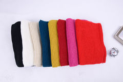 Wool scarfs with different colors folded together Stock Image