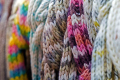 Wool scarves of various colors Royalty Free Stock Image