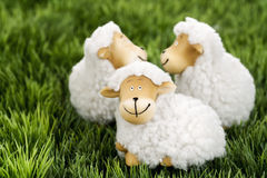 Wool sheep figurines on grass Royalty Free Stock Photo