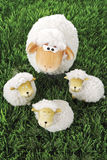 Wool sheep figurines on grass Stock Images