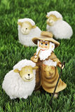 Wool sheep figurines and shepherd on grass Royalty Free Stock Images